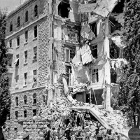 A British army officer and troops outside of the King David Hotel, which had been bombed by the underground Zionist group the Irgun, Jerusalem, July 1946