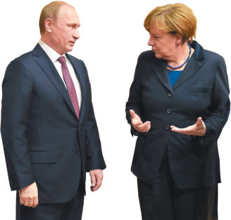 Vladimir Putin and Angela Merkel during peace talks over eastern Ukraine, Minsk, Belarus, February 2015