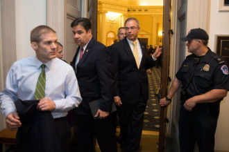 Representative Jim Jordan, Representative Raul Labrador, both Freedom Caucus members, and others, leave a hearing room on Capitol Hill after a nomination vote to replace House Speaker John Boehner fell apart, Washington, DC, October 8, 2015