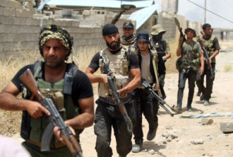 Members of an Iraqi Shiite militia joining Iraqi forces trying to retake Baiji from ISIS, June 9, 2015