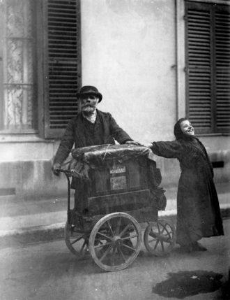'Hurdy-gurdy man and street singer'; photograph by Eugène Atget, Paris, circa 1898–1899