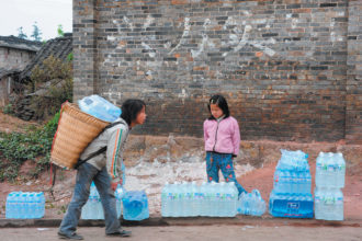 Children carrying bottled drinking water during China's worst drought in a century, Qinglong, Yunnan province, April 2010