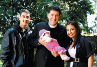 Father Alberto Cutié, who left the Catholic Church and married in 2009, with his wife, stepson, and infant daughter, Biscayne Park, Florida, 2011