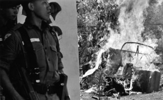 Indonesian soldiers near the burning wreckage of a vehicle, following the assassination of six army generals, Jakarta, October 1965