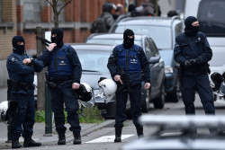 Police searching for a suspect of the Paris attacks in Brussels, Belgium, November 16, 2015