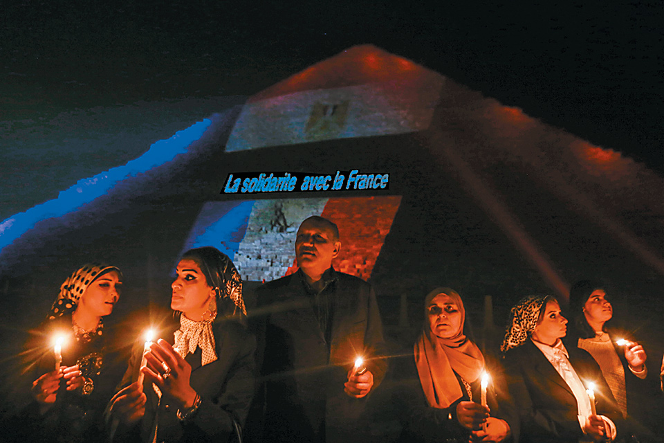 Egyptians attending a vigil at the Giza pyramids, near Cairo, for the victims of the recent attacks—claimed by ISIS—on Paris, Beirut, and the Russian passenger jet that exploded over the Sinai Peninsula, November 15, 2015