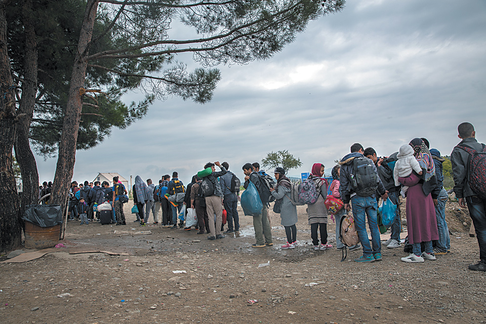 Refugees and migrants waiting to cross the border from Greece to Macedonia, October 2015