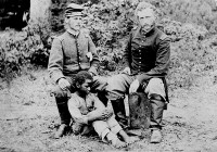 George Armstrong Custer, right, with his captured West Point classmate Confederate Lieutenant James B. Washington and an escaped slave after the Battle of Fair Oaks, or Seven Pines, Virginia, May 31–June 1, 1862