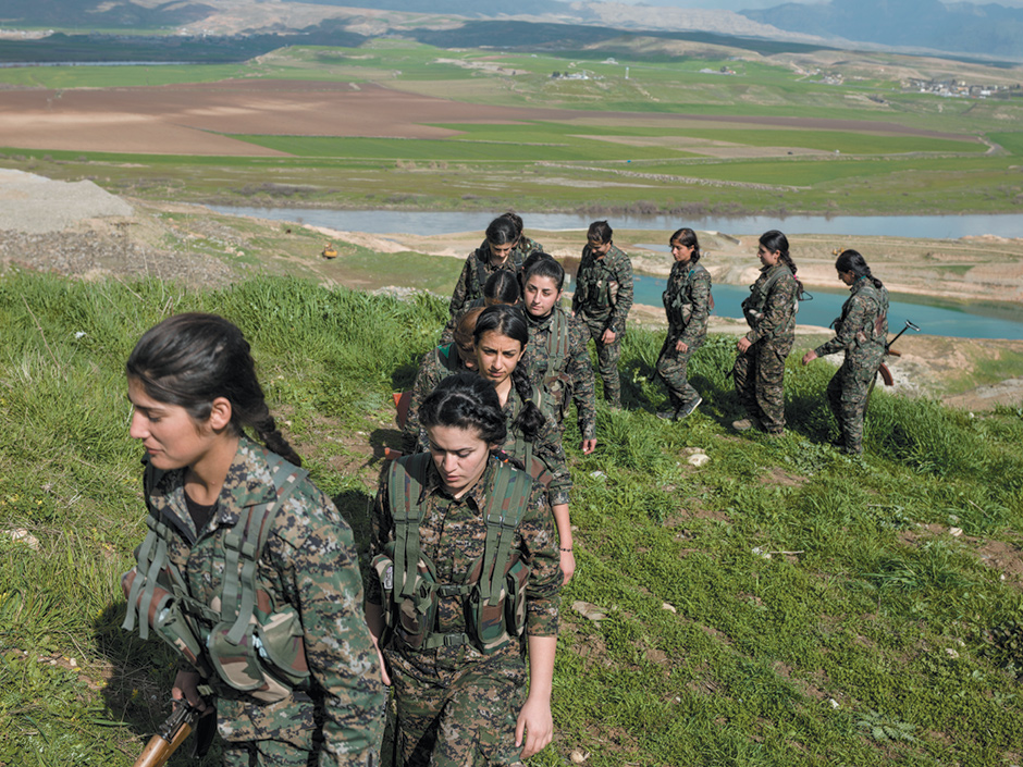 Kurdish fighters in the Women's Protection Unit during their daily drills at Shilan Camp, in the border region of Andivar, Rojava, Syria, summer 2015