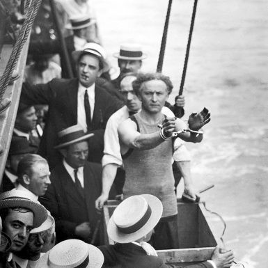 Harry Houdini, about to be padlocked into a packing case and lowered into New York Harbor, 1914