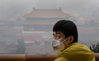 A man in Jingshan Park, overlooking the Forbidden City, Beijing, China, December 8, 2015