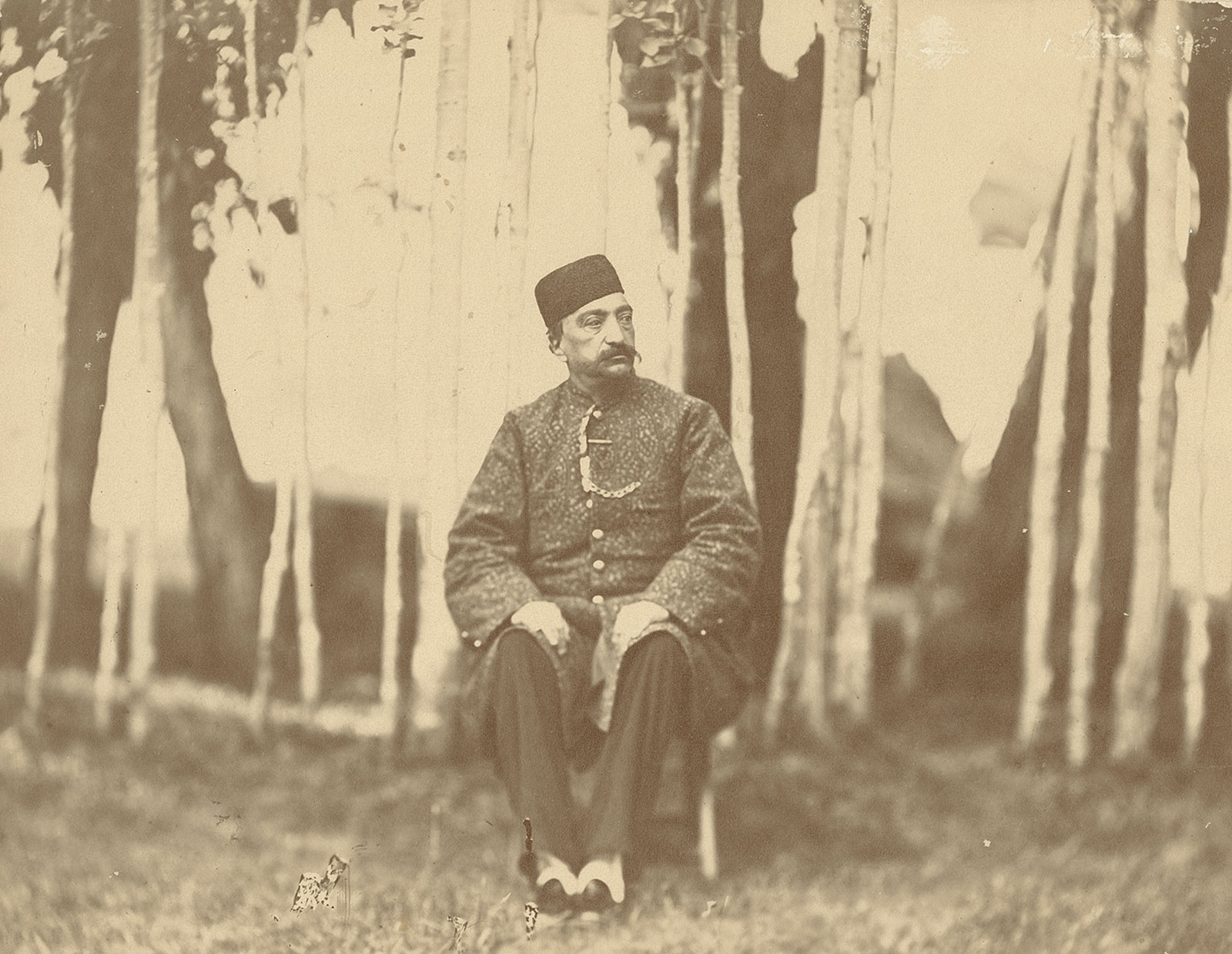 Seated Portrait of Naser al-Din Shah Qajar, taken by an unknown photographer, late nineteenth century