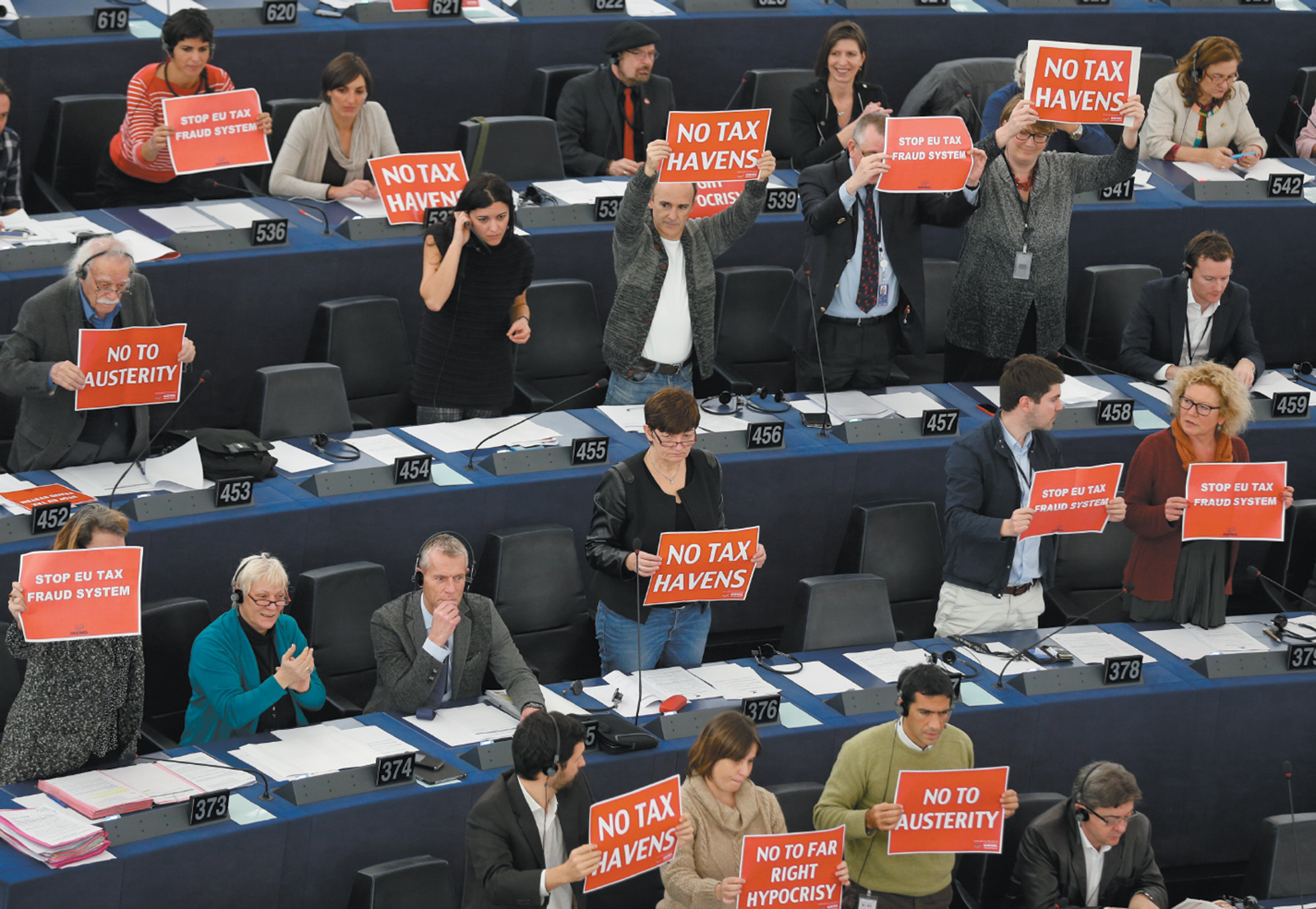Members of the European Parliament in Strasbourg, France, holding signs in support of a motion to censure the European Commission under Jean-Claude Juncker because of the aggressive tax-avoidance policies pursued by Luxembourg while Juncker was prime minister, November 2014