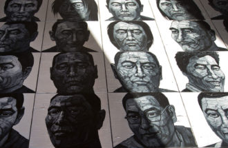 Liu Yi's portraits of Tibetans who have self-immolated, Songzhuang art village in Tongzhou, on the outskirt of Beijing, December 25, 2012