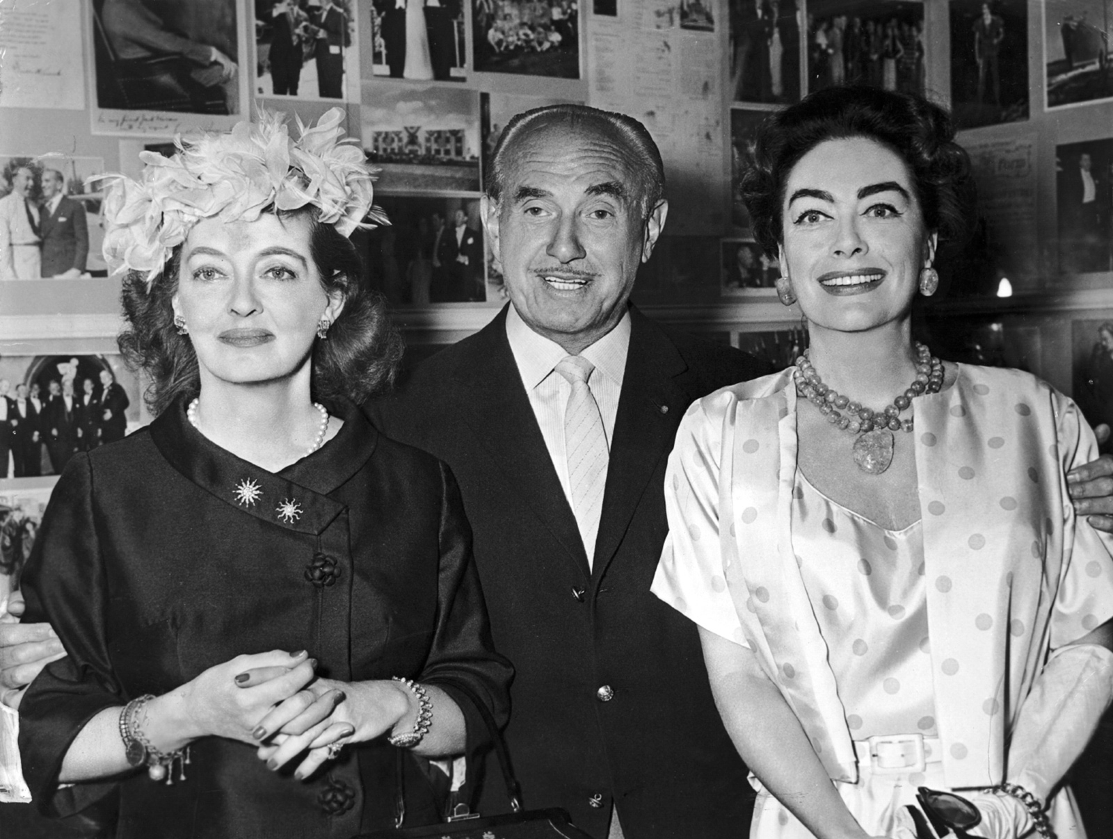 Jack Warner with Bette Davis and Joan Crawford, stars of the Warner Brothers film What Ever Happened to Baby Jane?, circa 1962