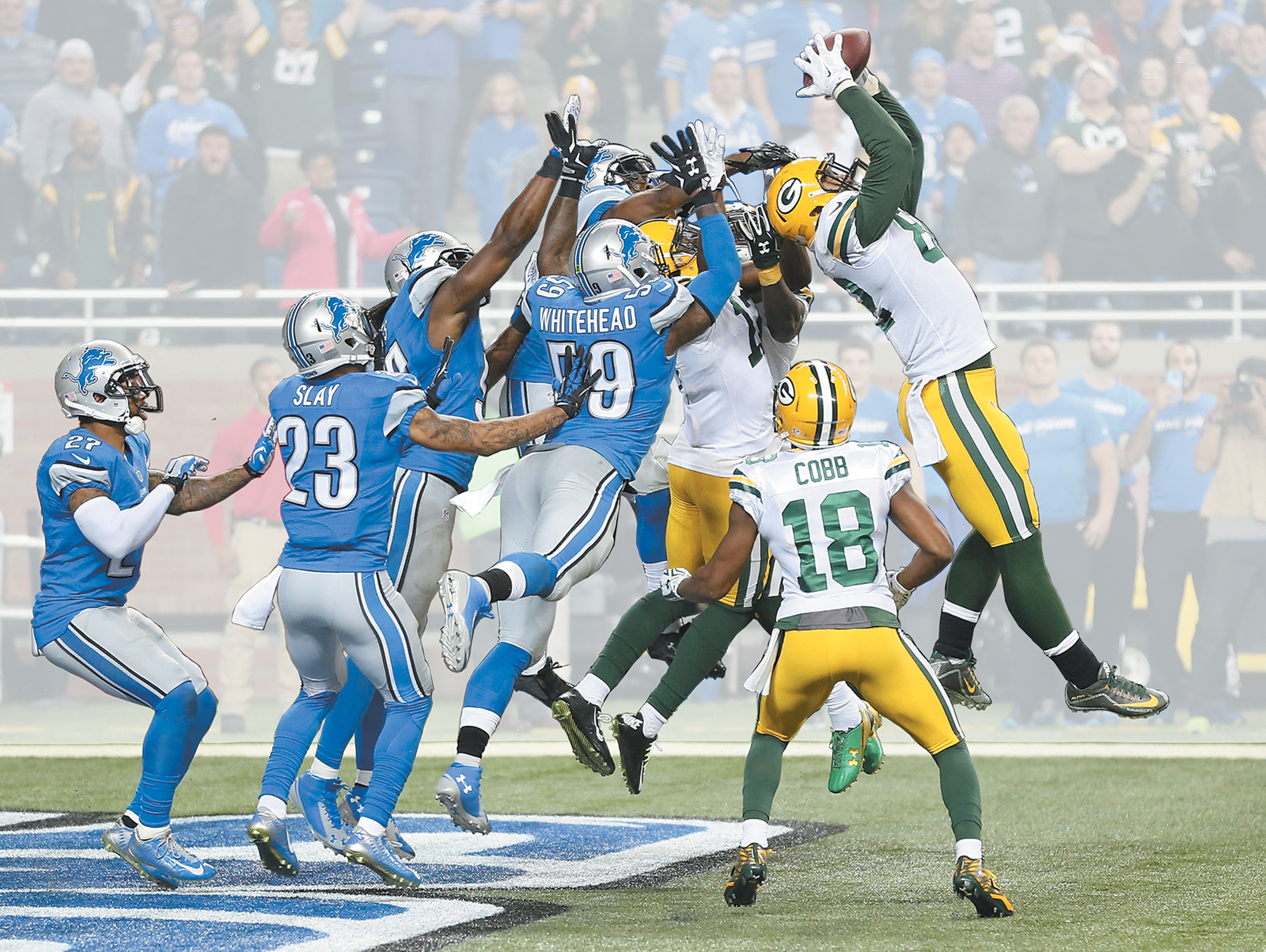 Richard Rodgers of the Green Bay Packers catching Aaron Rodgers's seventy-yard pass to win the game against the Detroit Lions, December 3, 2015
