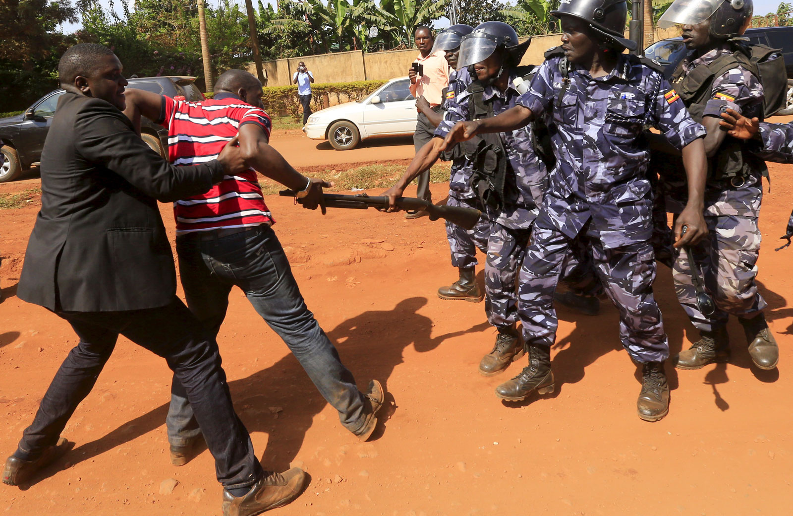 Riot police dispersing a gathering of opposition supporters in Jinja, eastern Uganda, September 10, 2015