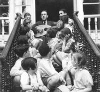 Rabbi Erwin Zimet singing with the twelve Jewish children whom Ian Buruma's grandparents rescued from Nazi Germany in early 1939, at the hostel they set up for the children in Highgate, North London