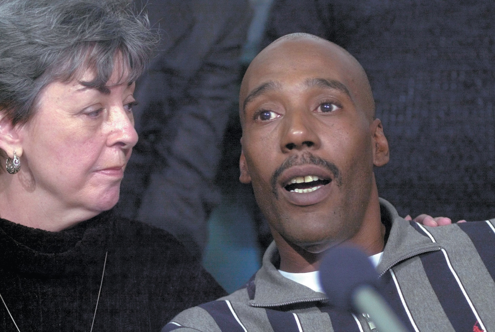 Earl Washington, who in 1984 was wrongfully convicted of rape and murder, with Marie Deans, a member of his legal team, at a press conference in Virginia Beach after he was freed from prison, February 2001. Washington spent more than seventeen years in prison—many of them on death row—and once came within nine days of execution. He was exonerated after DNA testing proved his innocence.