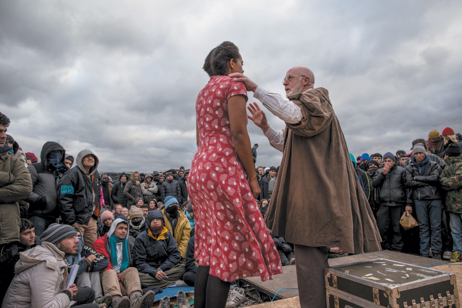 Actors from the Globe Theatre performing Hamlet for refugees and migrants in the Jungle refugee camp, Calais, France, February 2016
