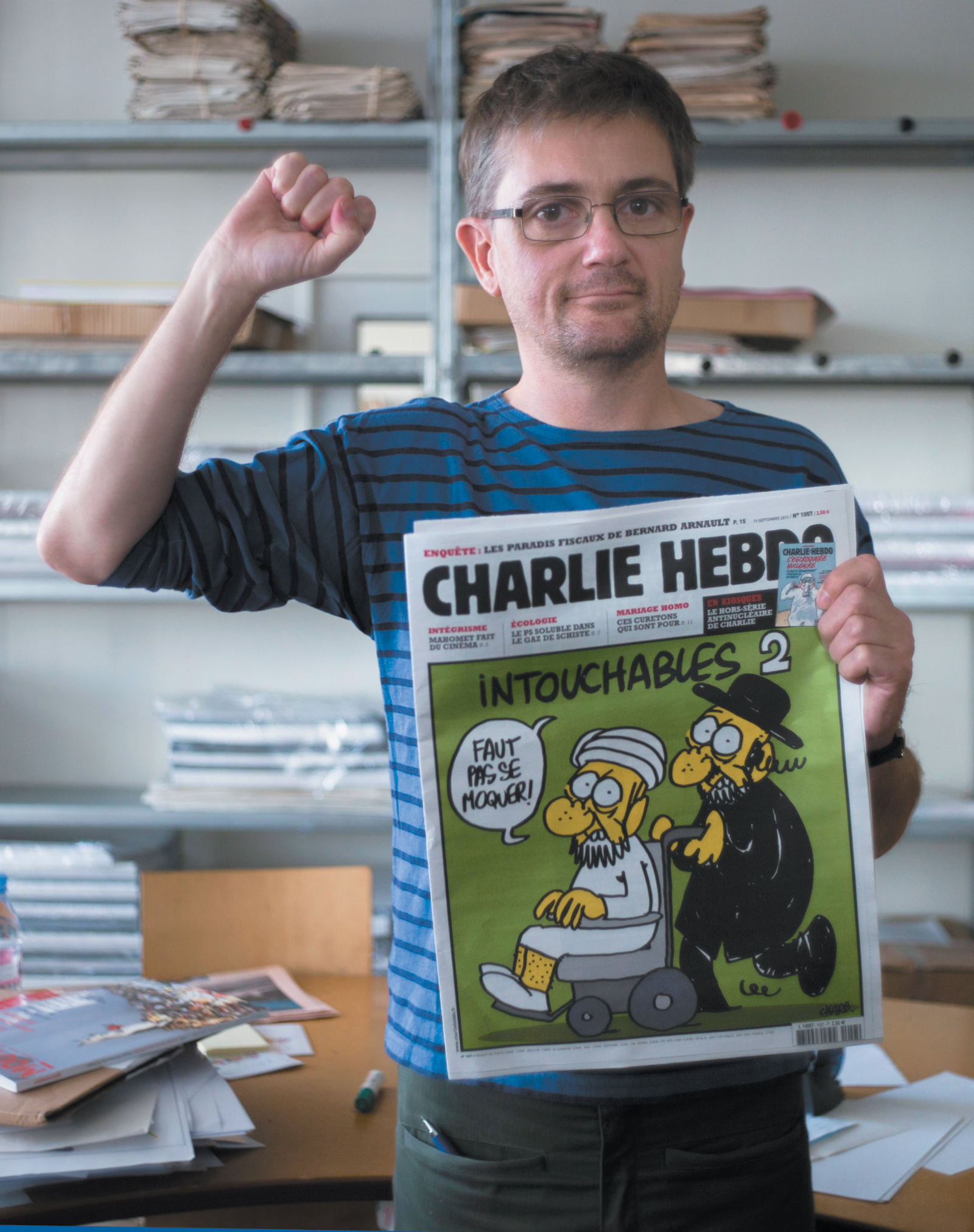 Stéphane Charbonnier, known as Charb, the editor in chief of Charlie Hebdo from 2005 until his death in 2015, at the magazine's office in Paris, September 2012