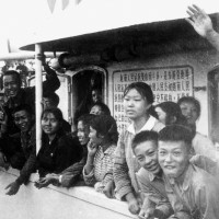 Chinese middle school graduates (zhiqing), 15 million of whom were 'sent down to the countryside and up to the mountains' to 'learn from the peasants' during the Cultural Revolution, aboard a Red Guard ship that was about to sail from Guangzhou to Hainan Island