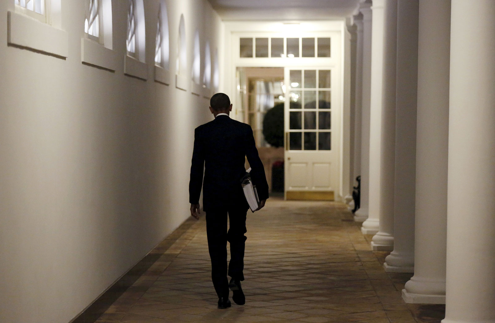 President Barack Obama carries a binder containing material on potential Supreme Court nominees, Washington, D.C., February 19, 2016