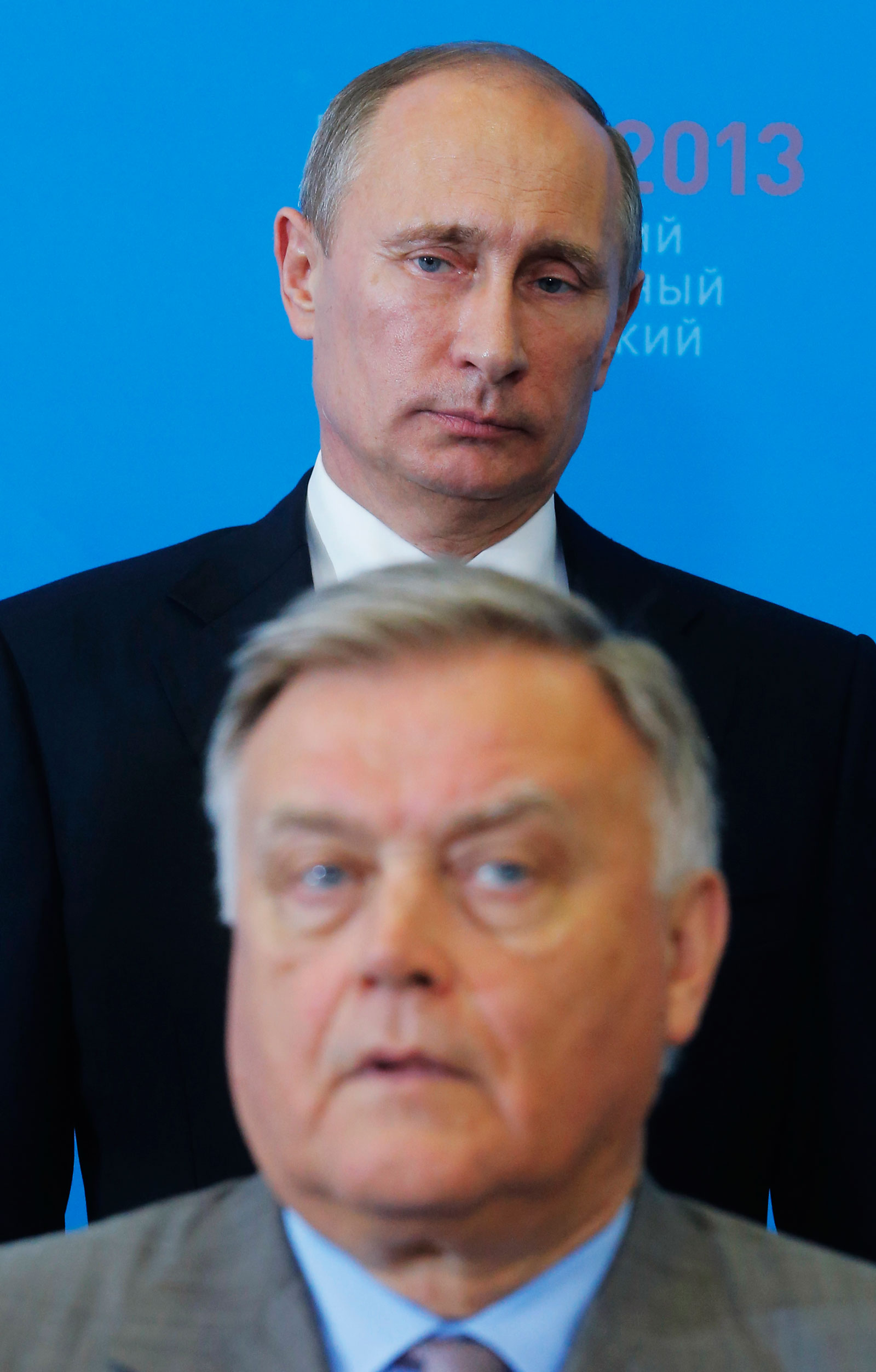 Russian President Vladimir Putin and former Russian Railways chief Vladimir Yakunin at the St. Petersburg International Economic Forum, Russia, June 20, 2013