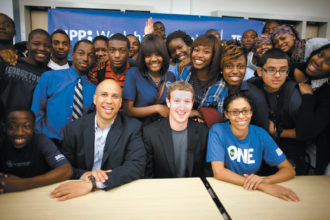 Cory Booker, then mayor of Newark, and Facebook CEO Mark Zuckerberg with eleventh-grade math students at the KIPP Newark Collegiate Academy, a charter school, September 2010