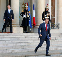 European Council President Donald Tusk leaves the Elysee Palace following a meeting with French President Francois Hollande in Paris, France, November 23, 2015