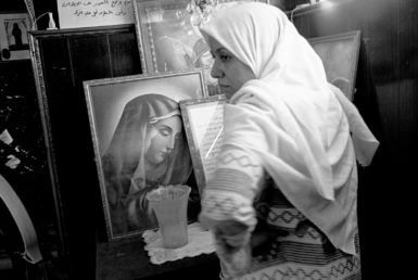 A Muslim woman asking for protection from black magic inside the shrine of Abba Ruwais, a Copt saint, Cairo, Egypt, 1997