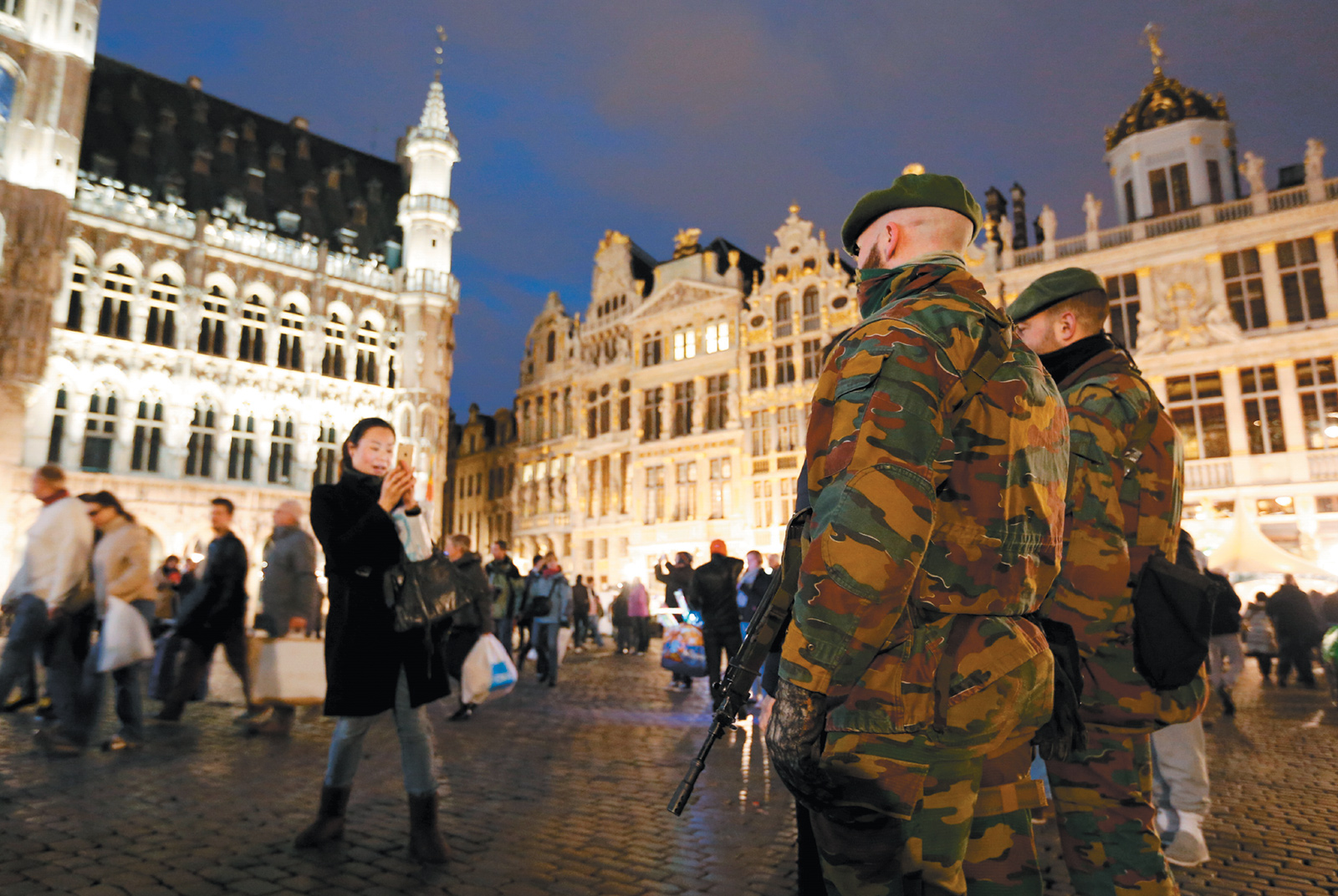 Belgian soldiers posing for a photograph while patrolling the Grand Place, Brussels, December 24, 2015