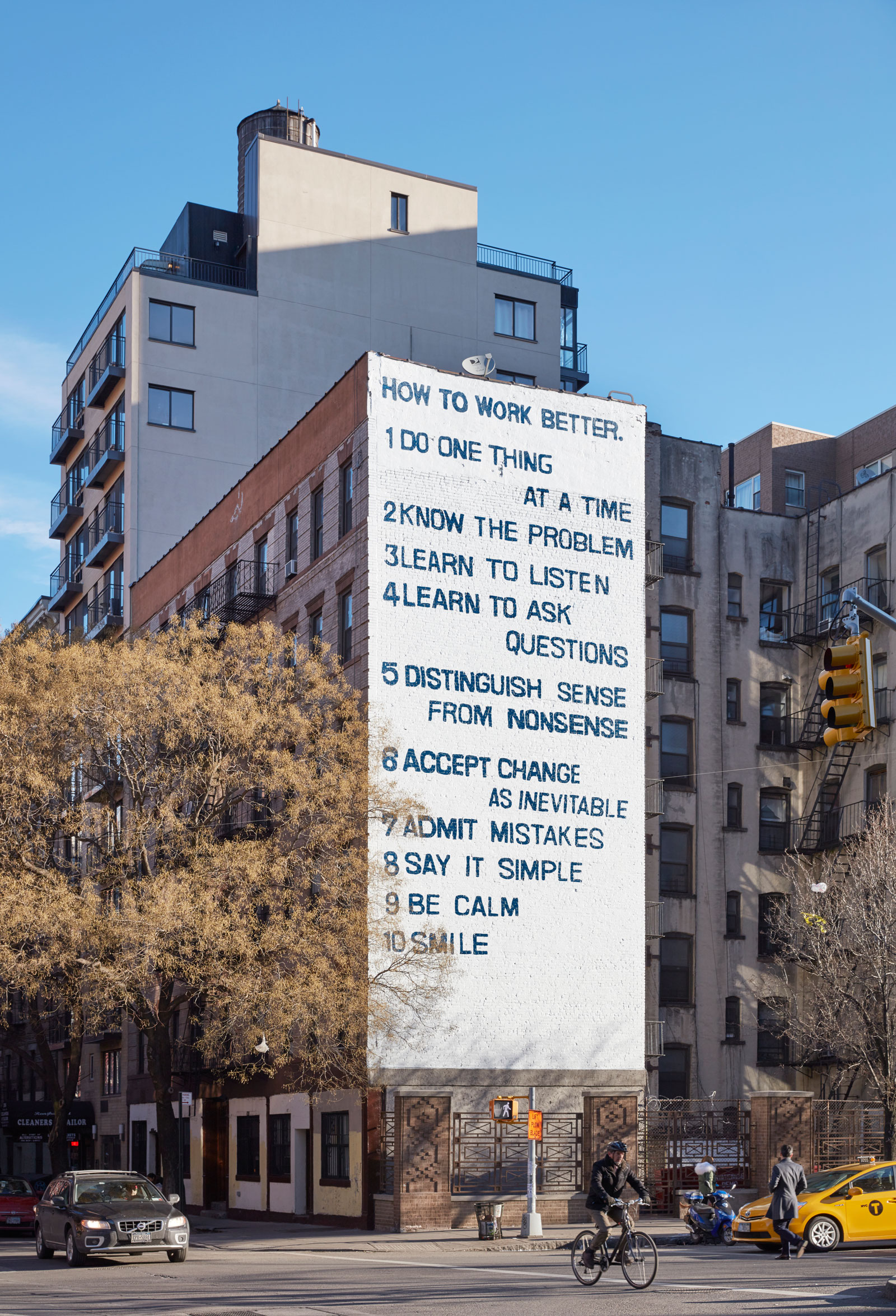 """Peter Fischli and David Weiss's """"How to Work Better"""" mural, on the corner of Houston and Mott Streets, New York City, 2016"""