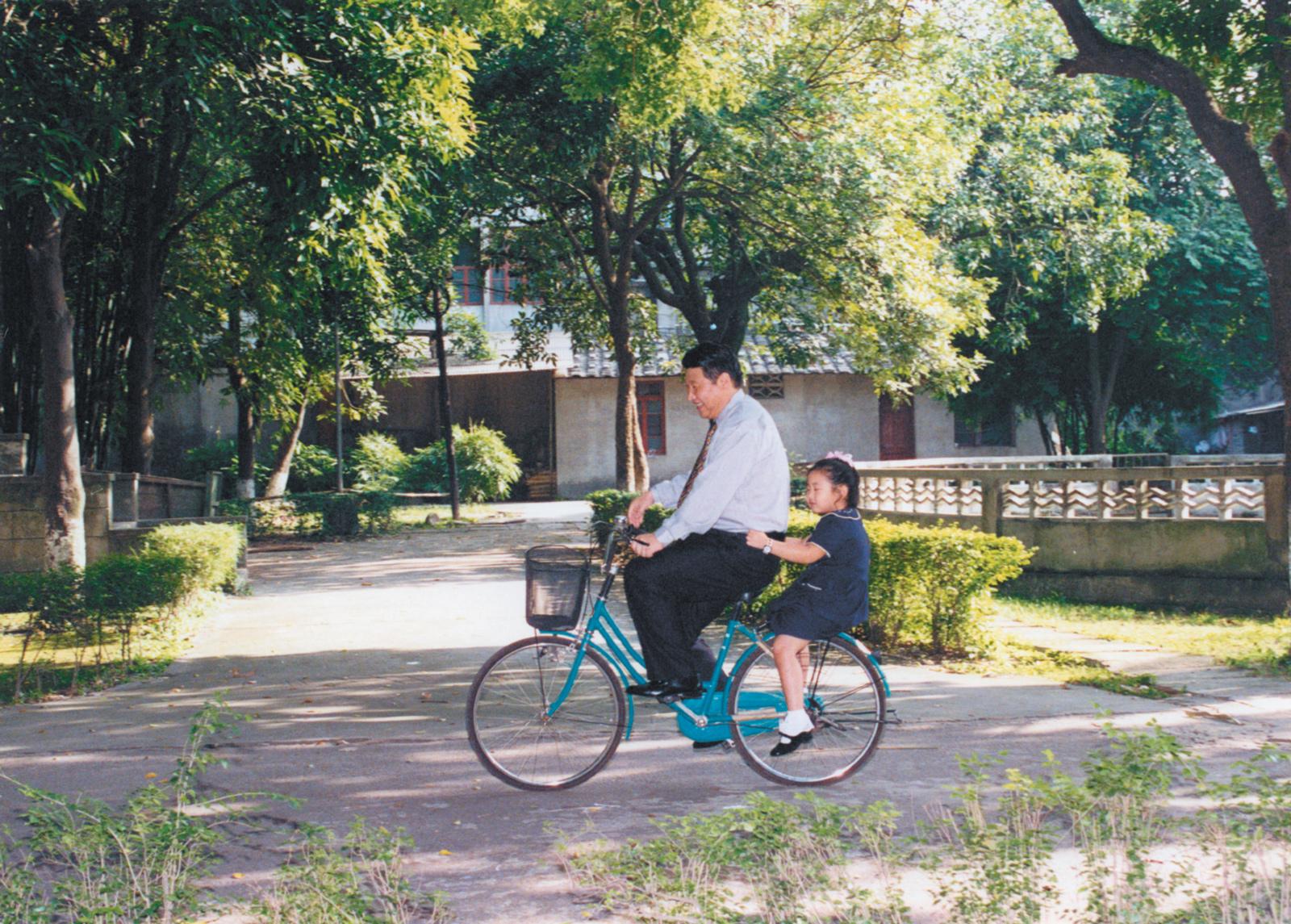 Chinese President Xi Jinping and his daughter, Xi Mingze, in Fuzhou, Fujian province, when she was a child
