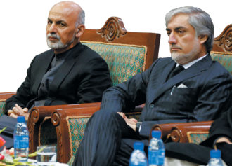 Afghan President Ashraf Ghani and Chief Executive Abdullah Abdullah on the first anniversary of the death of former vice-president Mohammad Qasim Fahim, also known as the 'marshal of Afghanistan,' Kabul, March 2015