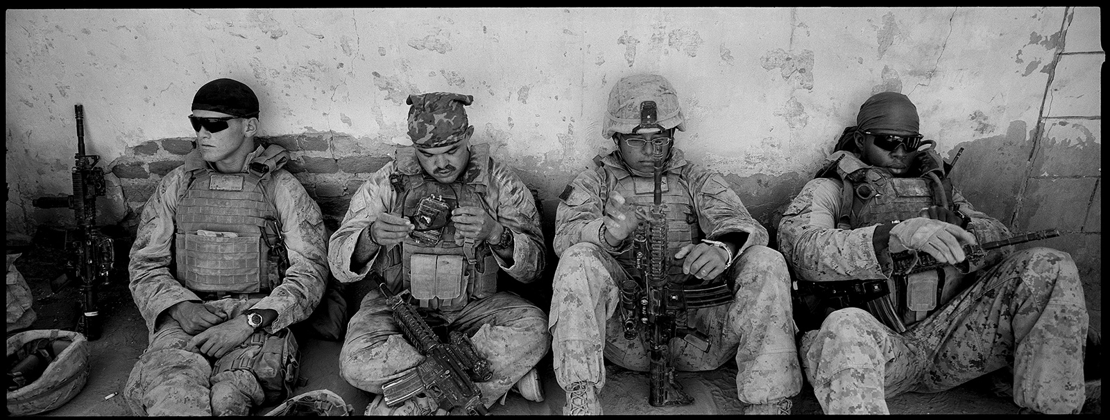 US Marines about to go on patrol in Khan Neshin, Helmand province, Afghanistan, 2009; photograph by Stephen Dupont from his book Generation AK: The Afghanistan Wars 1993–2012, published last fall by Steidl