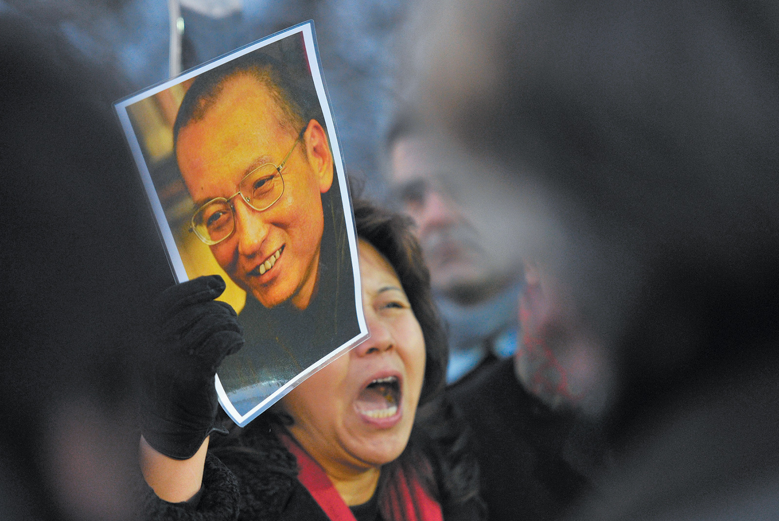 A protester holding an image of the imprisoned Chinese poet and Nobel Peace Prize laureate Liu Xiaobo, Oslo, December 2010