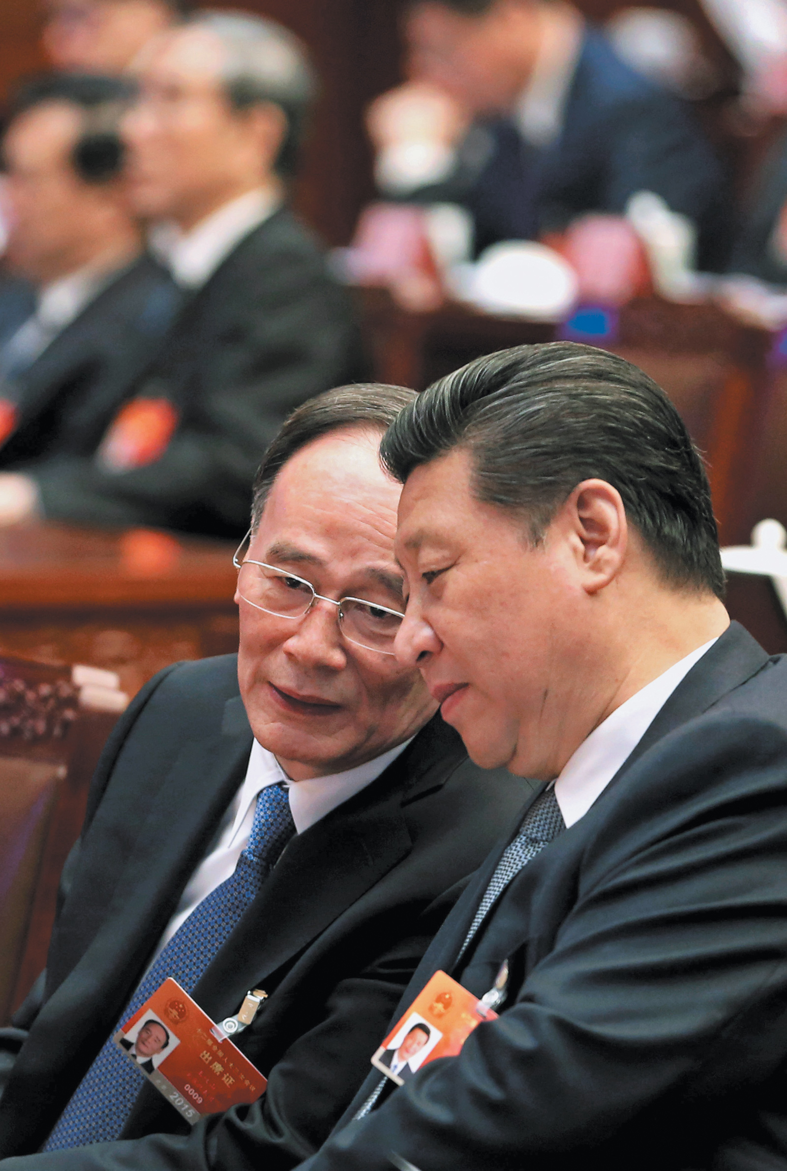 Chinese Communist Party General Secretary Xi Jinping, right, with Wang Qishan, who has been a major force in the recent crackdown as secretary of the Central Commission for Discipline Inspection (CCDI), at the National People's Congress, Beijing, March 2015