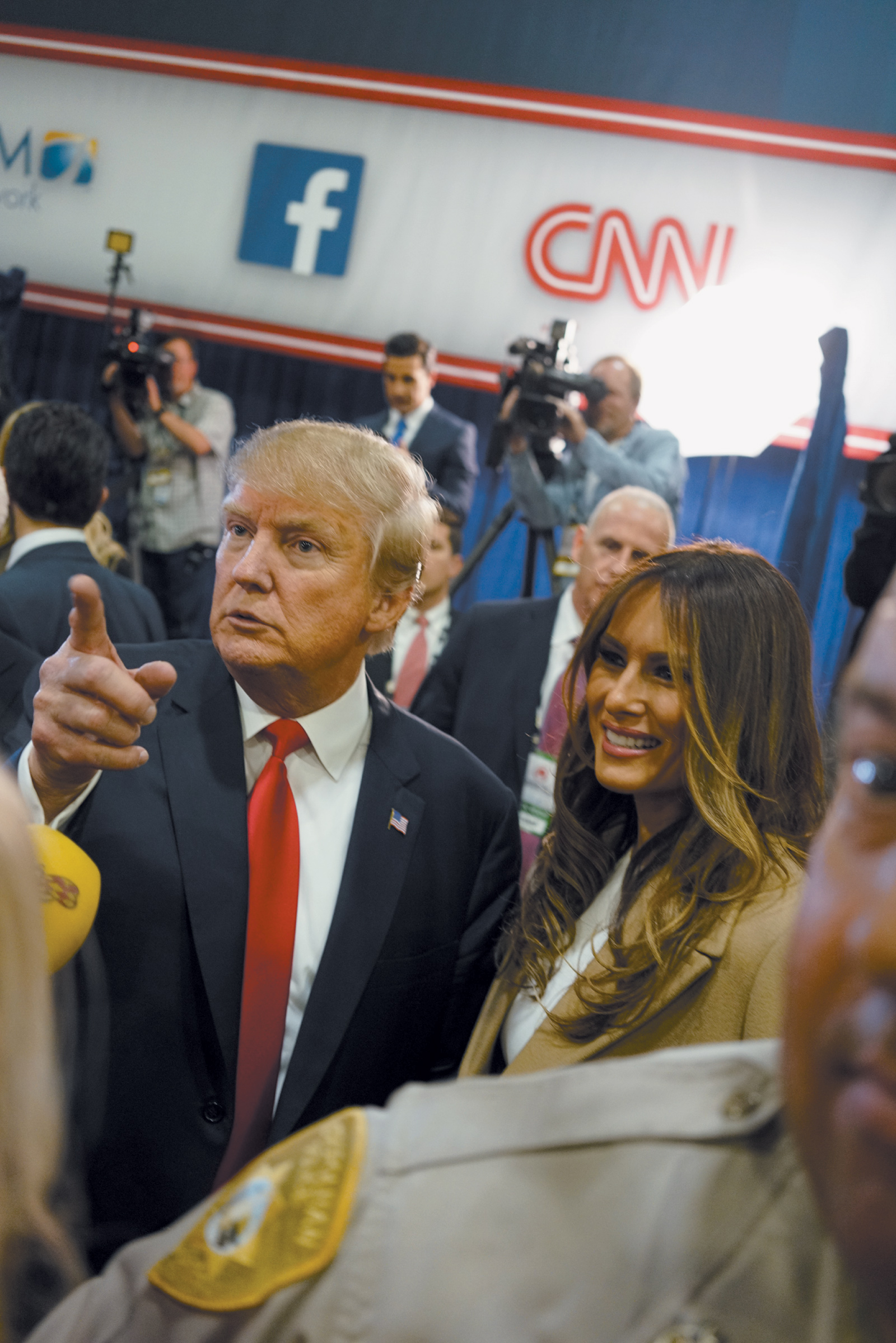 Donald and Melania Trump with reporters in the spin room after the Republican presidential debate in Las Vegas, December 2015