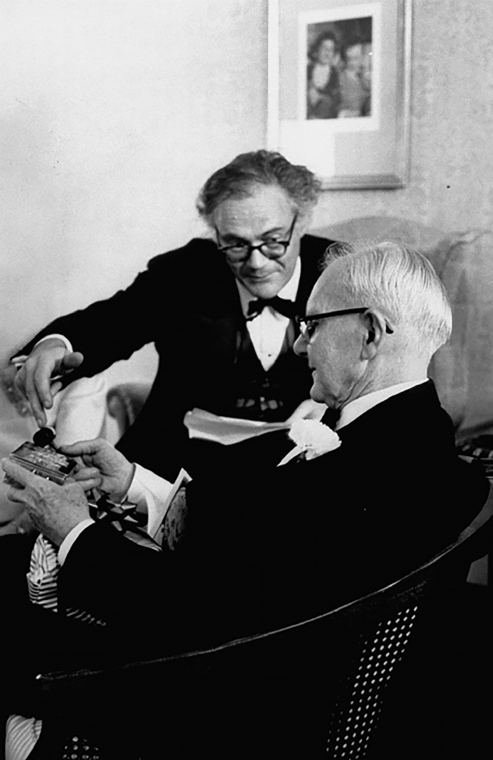 Robert Lowell giving John Crowe Ransom a gift for his eightieth birthday, 1968