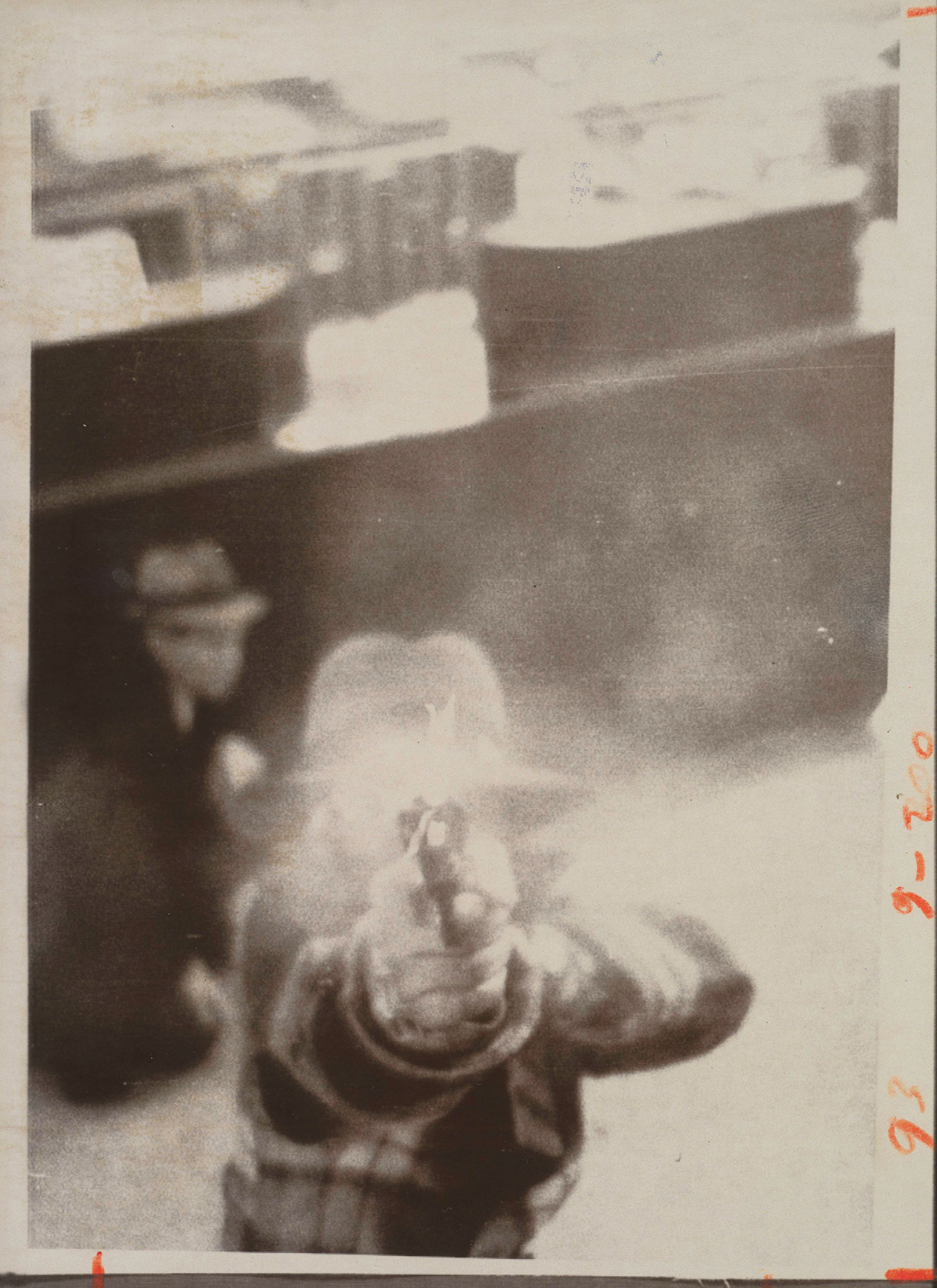 A bank robber aiming at a security camera, Cleveland, March 8, 1975