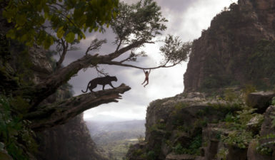 Bagheera, voiced by Ben Kingsley, and Mowgli, played by Neel Sethi, in Jon Favreau's The Jungle Book, 2016