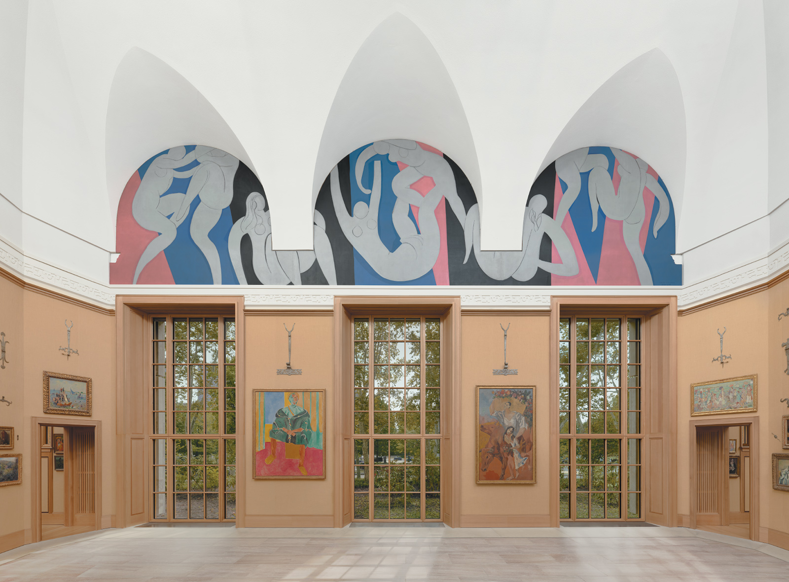 Matisse's first major mural, The Dance (1932–1933), commissioned by Albert Barnes in 1930 and installed at the new Barnes Foundation museum building in Philadelphia in 2012. Below are works by William James Glackens, Matisse, Picasso, and Maurice Brazil Prendergast.