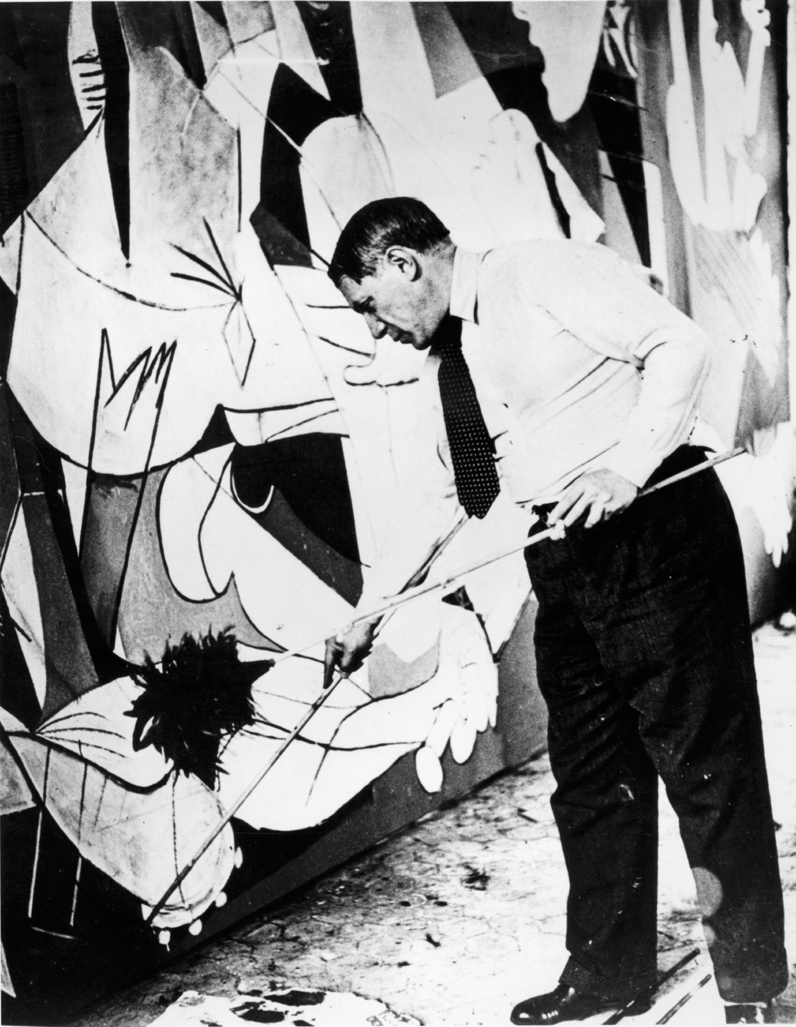 Pablo Picasso painting Guernica in his studio, Paris, 1937; photograph by Dora Maar