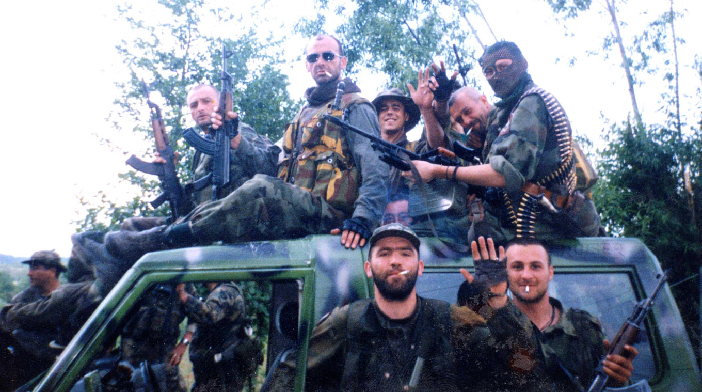 """Ranko Momić, Slaviša Kastratović, and Milutin Nikolić, with other members of the """"Jackals,"""" Kosovo, 1998, from the documentary The Unidentified, by Marija Ristić and Nemanja Babić, 2015"""