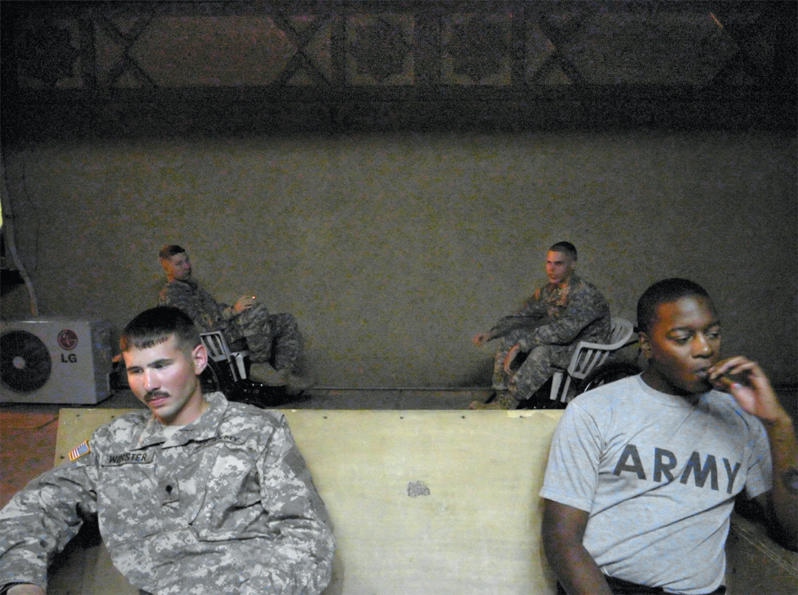 Army medic James Worster (left) with fellow soldiers in Baghdad, 2006. Worster, who worked in a combat support hospital, suffered from PTSD and died of an overdose days before the end of his second tour.