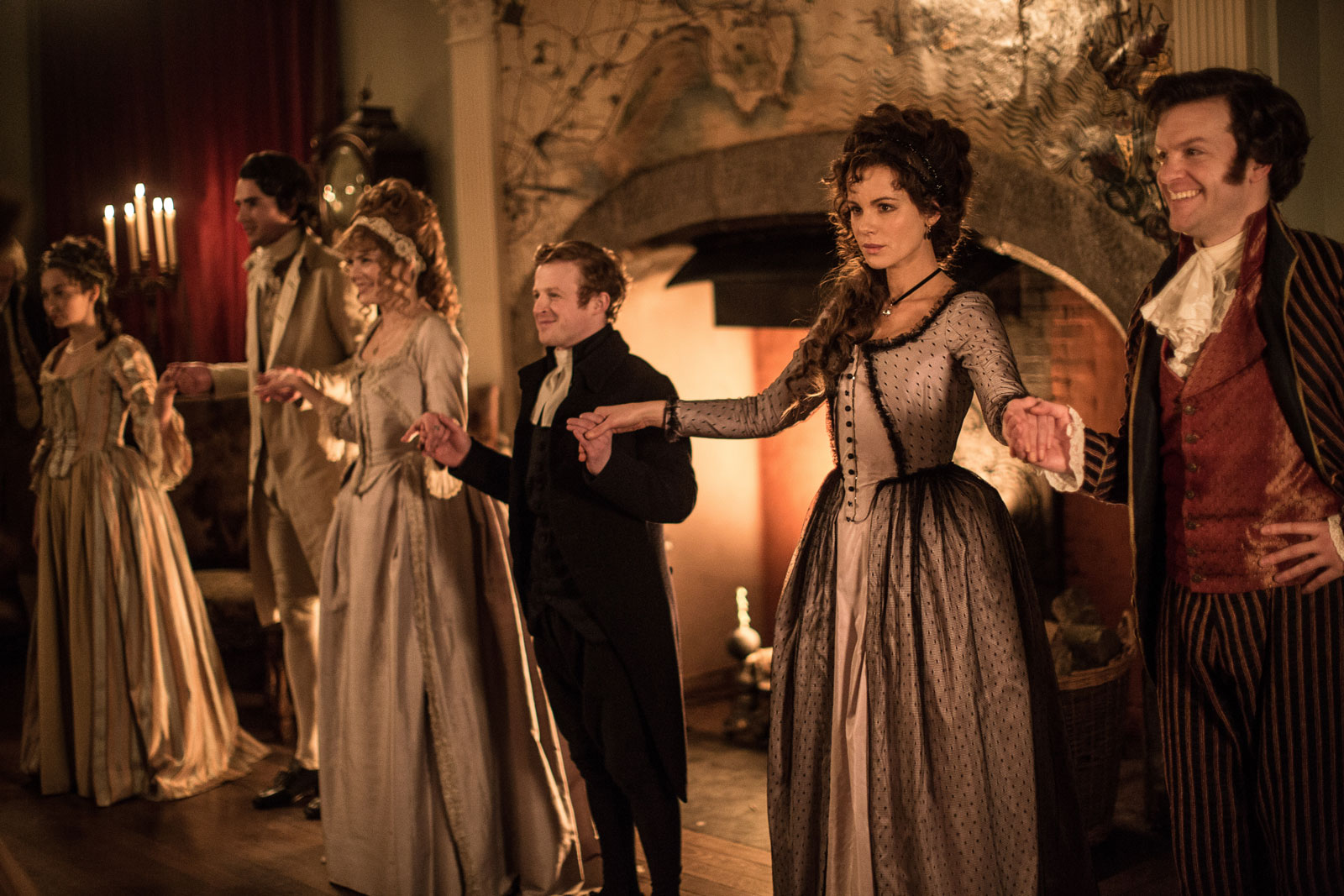 Kate Beckinsale as Lady Susan Vernon (right) and Tom Bennett as Sir James Martin (far right) in Whit Stillman's <em>Love & Friendship</em>, 2016