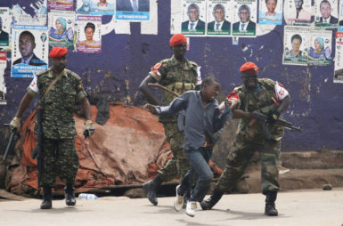 Police chasing a supporter of Ugandan opposition leader Kizza Besigye, Kampala, Uganda, February 19, 2016
