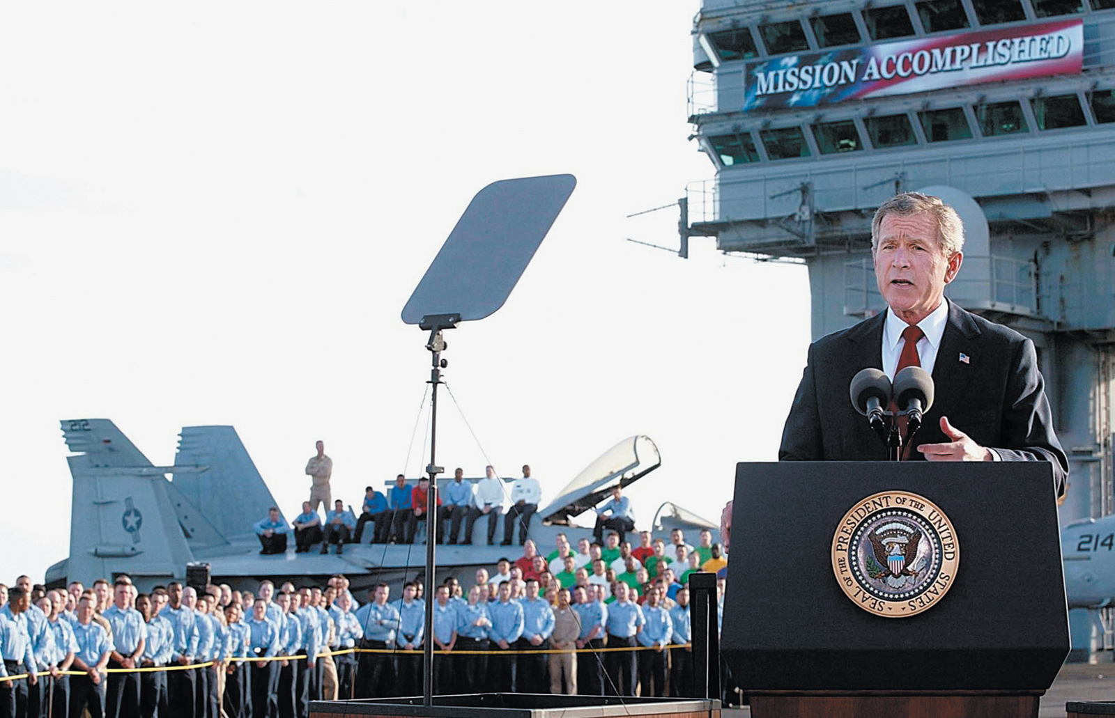 George W. Bush on the deck of the USS Abraham Lincoln, declaring the end of major fighting in Iraq, May 2003