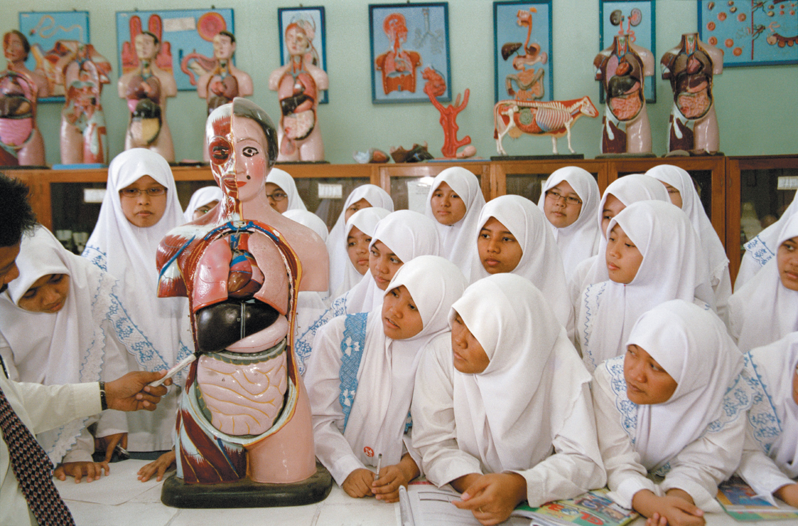 Students in a biology class at a religious boarding school run by the Muhammadiyah organization, Solo, Indonesia, 2004